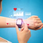 Female hand with smartwatch