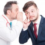 Male Doctor Whispering